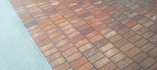 Power washing and surface cleaning and gum removal on a sidewalk in Temple TX, after photo.