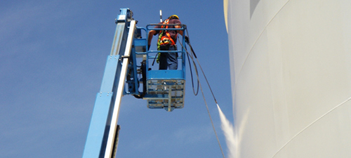 Industrial pressure cleaning services for large storage containers and buildings.