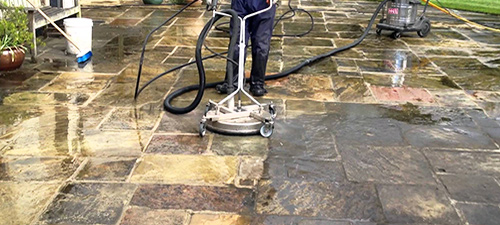 Stone patio power washer and pressure cleaner surfaces on a house patio in Belton TX.